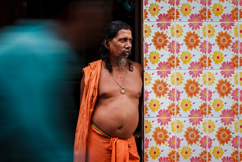 The Cycle of Life: A sadhu contemplates as a cyclist whizzes past him in the bylanes of Puri
