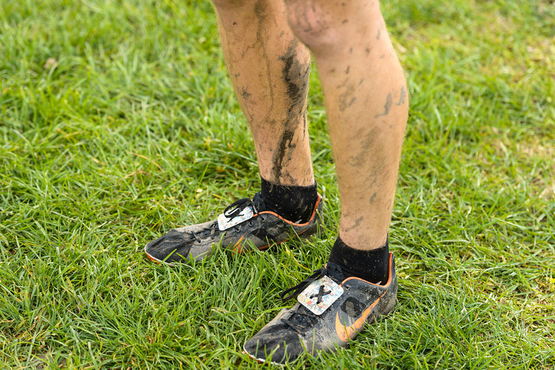 Matt Dorsey of Lawrence Central shows the effects of racing on a cool, muddy day at the IHSAA Boys Cross Country Carmel Semi-State at Northview Christian Church in Carmel, Indiana on Saturday, October 20, 2012. Matt finished fourth  and Lawrence Central goes on to the State Finals next week.  Kirk Taylor/For the Star