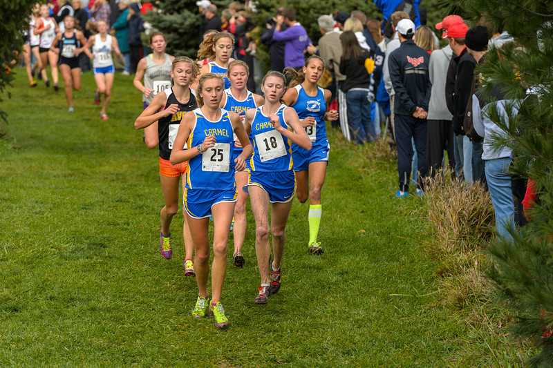 Carmel has four girls - Ellen Schmitz (25), Gina Genco (18), Kelcy Welch (28) and Samantha Dauby (49) -  up front midway in the IHSAA Girls Cross Country Carmel Semi-State at Northview Christian Church in Carmel, Indiana on Saturday, October 20, 2012.  Kirk Taylor/For the Star