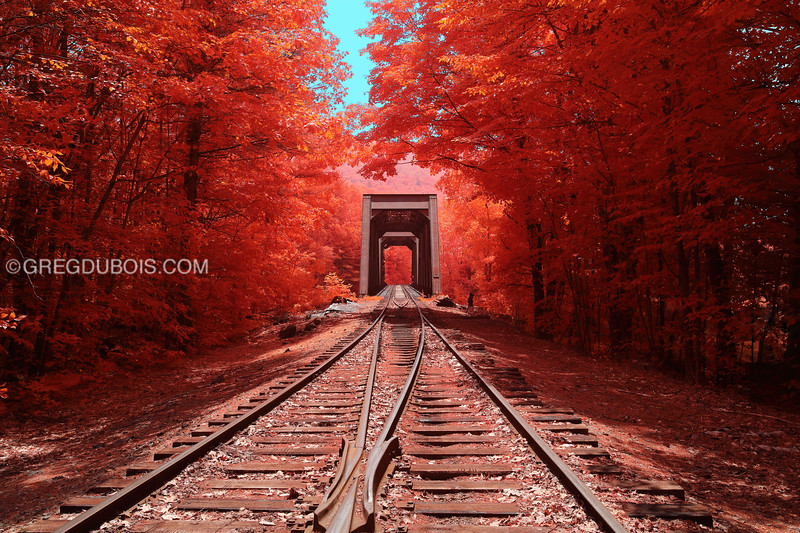 Historic Railroad Trestle in White Mountains New Hampshire with Blue Sky and Fall Colors