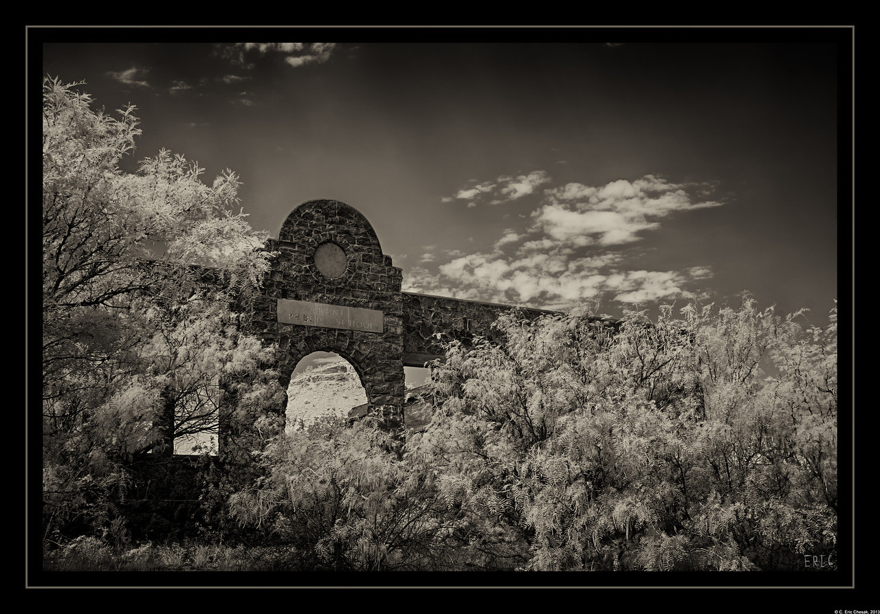 Doorway to the Past<br /> <br /> The remains of the Kent Public School, located along Interstate 10 in Culberson County, nearly covered in Mesquite. Likely built in the early 1900's. Kent is classified as a Ghost Town, as there are very few residents and many abandoned buildings and businesses.<br /> <br /> Date:June 21, 2013<br /> <br /> Camera: Full Spectrum converted Canon 40D<br /> Lens: Canon EF24-70 f2.8L<br /> Filter:Astronomik Proplanet 742 Clip-in<br /> Tripod: Induro AT313 with BH-2 Ball Head<br /> Exposure: ISO 100, f11<br /> 2-exposure composite, just as the clouds shaded the school