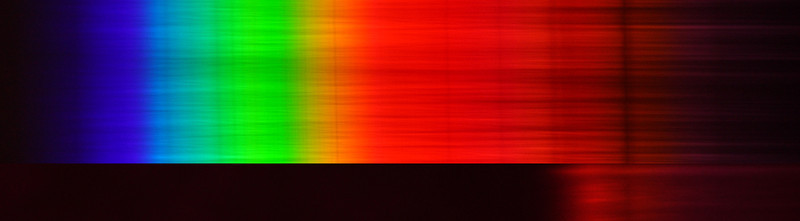 The Top spectrum is the full spectrum from a full spectrum Canon 40D, using a homemade transmission holographic grating.  The bottom spectrum uses the same camera and grating, but includes the Astronomik Pro-planet 742 IR filter (hopefully aligned correctly). It may appear that the spectrum (with the filter) extends further in the IR, but it's just a difference in exposures of the two spectra.  These are raw, unprocessed spectra.