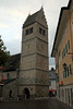 St. Hippolyte Pfarrkirche (parish church) - 11th century Romanesque construction, the tower was completed about two centuries later - in town of Zell am See - from the town square, cloudy