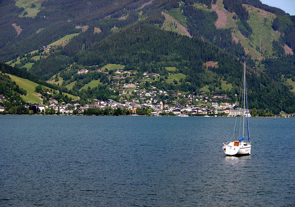 Across Zeller See (Lake Zell) - and the sailboat - to the town of Zell am See (Zell by the lake) - Zell meaning cell (like a monk's cell in a monestery) - from here in Thumersbach (town).