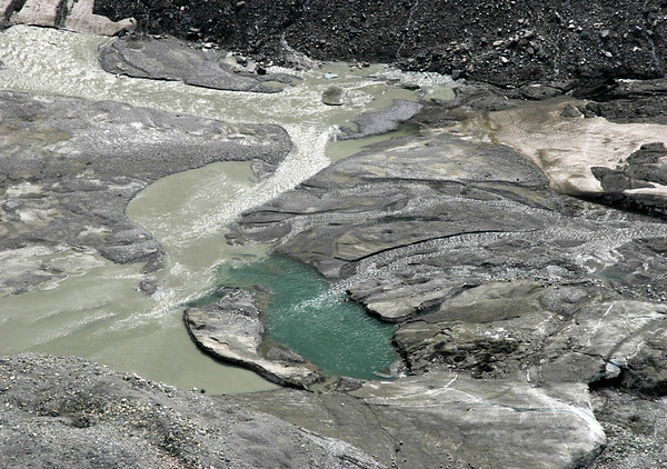 """Glacial Pool - at the very southern end of the Pasterze Glacier - with """"glacial milk"""" - created by the suspension of """"glacial flour"""" (the fine-grained, silt-sized particles of rock, that is generated by frictional grinding of bedrock by glacial erosion) in the water from melted glacial ice, firn, neve, and snow - Hohe Tauern National Park"""