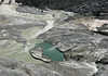 "Glacial Pool - at the very southern end of the Pasterze Glacier - with ""glacial milk"" - created by the suspension of ""glacial flour"" (the fine-grained, silt-sized particles of rock, that is generated by frictional grinding of bedrock by glacial erosion) in the water from melted glacial ice, firn, neve, and snow - Hohe Tauern National Park"