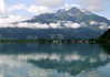 Across Zeller See (Lake Zell) - to Schuttdorf (town) - to the Granisiedlung, above the cumulus clouds - and the Hoher Tenn, directly beyond, rising to 11,050 ft. (3,368 m)