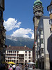 Stadtturm (City Tower) - Goldenes Dachl (Golden Roof) - with the Nordkette Range, under the cumulus clouds - Innsbruck