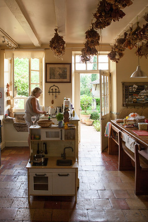 A Classic, traditional French kitchen. Note the children's 'range' in foreground, and the stone sink (evier) under the window on the left.