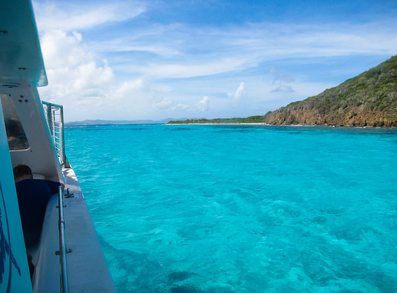 Boat in aquamarine waters off Buck Island, St. Croix
