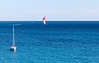 Blue sea and sailboats