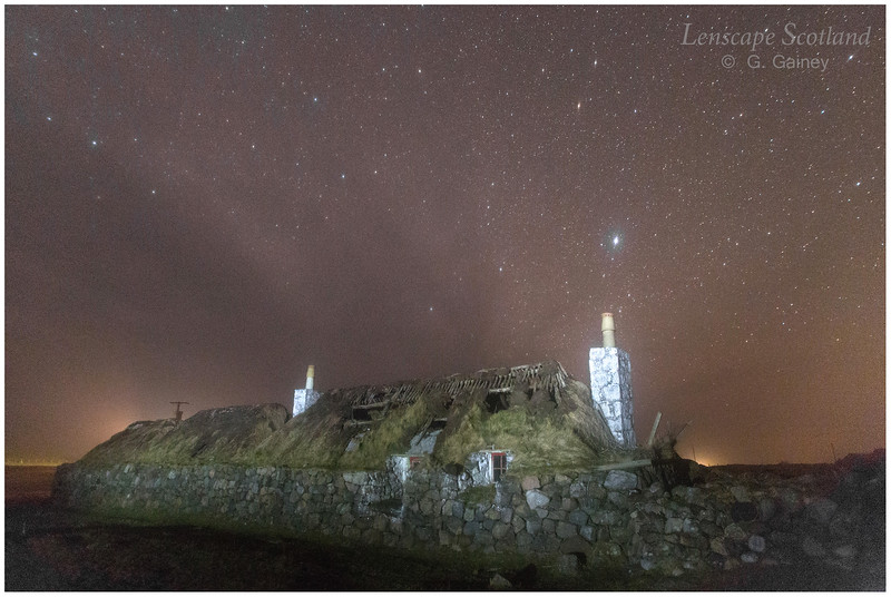 Derelict turf roofed cottage, Sandaig, with stars