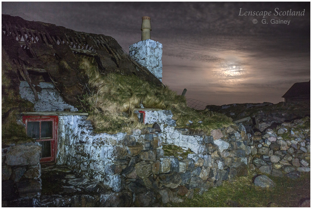 Derelict turf roofed cottage, Sandaig, with full moon