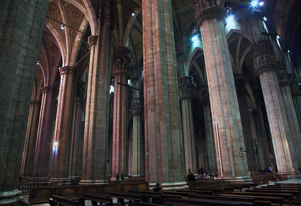 Columns along the triple nave of the Milan Cathedral - 52 columns rising 79 ft. (24 m) support the massive marble structure which took almost 600 years to complete - Milan