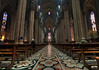 Duomo di Milano (Milan Cathedral) - down the main nave, extending 486 ft. (148 m), rising to 148 ft. (45 m), with the columns rising to 70 ft. (24 m) - to the high altar - Milan