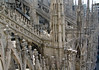 Gargoles protruding from the bases of the spires - with the flying buttress above - Milan Cathedral