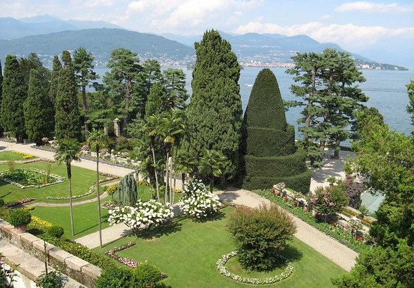 Garden of Isola Bella - viewing northward across Lake Maggiore, to the city of Verbania along the shoreline - with the Western Alps along the distal horizon