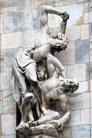 Statue along the wall of the Milan Cathedral