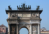 "Arco dela Pace (Arch of Peace) - Milan - the neoclassical monument was started in 1807 to celebrate Napoleon's victories and completed in 1838, the marble monument stands about 82 ft. (25 m) tall and around 79 ft. (24 m) wide - atop is the bronze ""Sestiga della Pace"" (Chariot of Peace, drawn by six horses), along with four goddesses of victory riding horses."