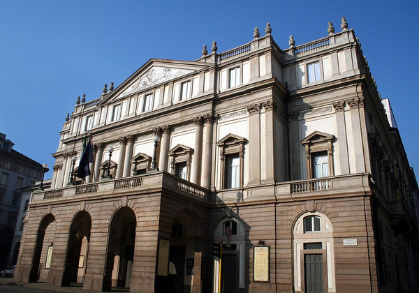 Teatro Alla Scala (opera house in Milan) - inaugurated in 1778, and destroyed during the bombardments of Milan in 1943 (WW ll) - however, it was the first public building that was reconstructed after the war, and was reopened in 1946 - the facade reveals a three-bay arched portico, topped by a neoclassical front with pilasters capped with corinthic capitals and a horse-drawn chariot bas-relief in the tympanum.