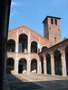 Basilica of Sant' Ambrogio - consecrated in 379 AD - its current Romanesque style appearance is from the 12th century - here showing southern arched cloister, the two loggias on the western facade of the basilica's narthex, and the northern brick tower (Campanile dei Monaci, built in the 9th century) - Milan