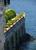 Along the afternoon shaded arched wall of the garden, on Isola Bella (island) - at the shoreline of Lake Maggiore