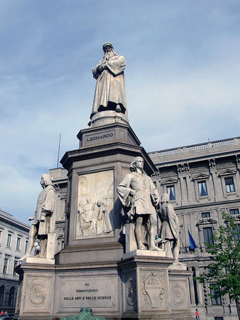 "Leonado da Vinci monument - in the Piazza della Scalla (square of the scale) - dedicated to ""al rinnovatore delle arti e delle sience"" (the innovator of art and science), was erected in 1919 to commemorate the 400 years since da Vincis death - four of his pupil's statues surround the base of the monument - Milan"