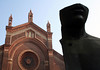 """Church of Santa Maria Del Carmine, built in 1446, with this terra-cotta brick facade constructed in 1880 - with the 1983 sculpture """"Le Grand Toscano (the grand Tuscan) by Igor Mitoraj - Milan"""