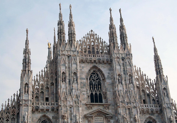 Cathedral of Milan - top of the eastern facade - with the gilded Madonnina (statue of the Virgin Mary) atop a spire at the western end