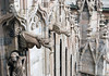 Statue and gargoyles along the wall of the Milan Cathedral