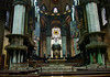 Milan Cathedral - from the crossing (intersection of the nave, transept, and chancel) to the twin pulpits, high altar, suspended tapestries and stained glass at the apse.