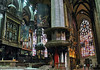 Pulpit, high altar, pipe organ, and tapestries at the chancel of the Milan Cathedral