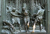 Persecution of Christ - one of the many biblical scenes designed into the brass door of the Milan Cathedral - with the shiny copper color created from the hundreds of thousands of people touching the oxidized brass.