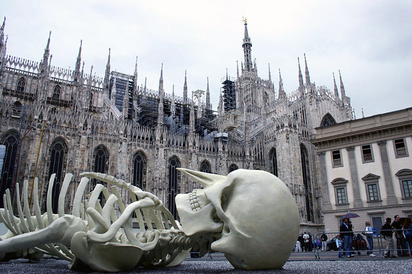 Calamita Cosmica (Cosmic Magnet) by Gino De Dominicis - laying in the Piazza del Duoma (Cathedral Square) - with the Milan Cathedral behind