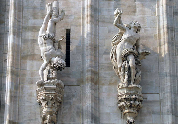 Allegoric statues along the marble walls of the Milan Cathedral