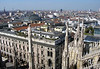 Viewing northwest from the statues atop the spires of the Milan Cathedral - to the massive glass-covered dome of the Galleria Vittoria Emanuele II - Milan