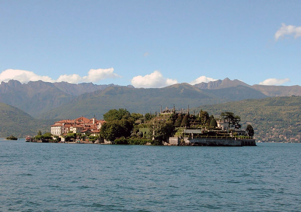 Isola Bella, this island was named after Isabella (countess Borromeo, wife of Carlo lll) - the Palace along the southwestern shore, of Lake Maggiori, and the Garden at the southeastern end - with Rocca di Angera (the small rock island) adjacent - and the Western Alps along the cumulus cloud skyline