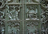 Biblical scenes sculpted into the central bronze door of the Milan Cathedral - notice the fragmented bronze (lower right), caused by the bombardment of Milan in 1943 (WW ll)