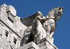 Statue atop the Stazione Centrale (Central Railway Station) - Milan - the 2nd largest train station in Italy in terms of size and traffic volume
