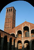 Basilica of Sant' Ambrogio - consecrated in 379 AD - its current Romanesque style appearance is from the 12th century - here showing the northern arched cloister, the two loggias (a gallery or corridor supported by columns or arched openings in the wall, to the open air on one side) on the western facade of the basilica's narthex, and the northern brick tower (Campanile dei Canonici, built in the 11th century) - Milan