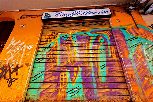 It was Sunday afternoon, so most businesses were closed and had their doors down, putting Bologna's serious graffiti problem on full display.