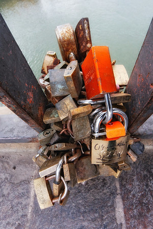 Locks locked to locks. It's similar to carving your name into a tree, although this may last even longer.