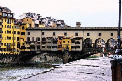 The oldest bridge in Florence, the Amo River, and a smoking Italian.