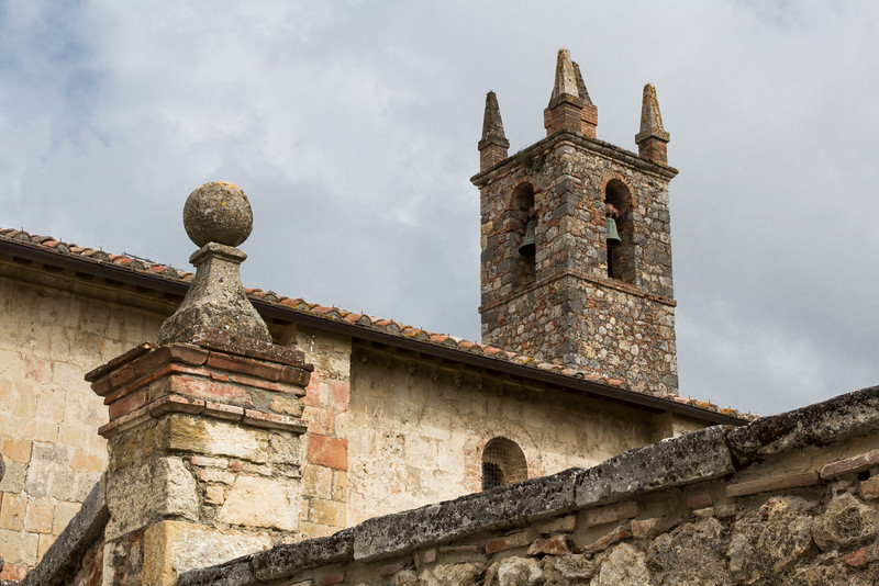 Close-up of medieval bell tower and roof, Monteriggioni, Italy