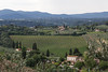 Sweeping view of cultivated fields and farmhouses, San Gimignano, Tuscany, Italy