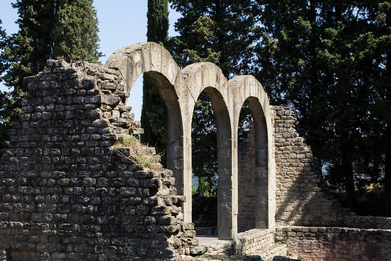 Three arches of Roman bath ruins in Fiesole, Tuscany, Italy