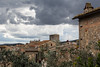 Roof tops on a stormy afternoon in medieval San Gimignano, Tuscany, Italy