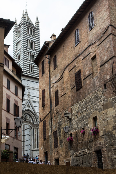 Narrow alley leading to the bell tower of the Cathedral in Siena, Italy