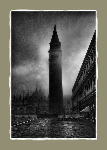 Tower at Piazza San Marco, dawn. Basilica bathed in fog in the background