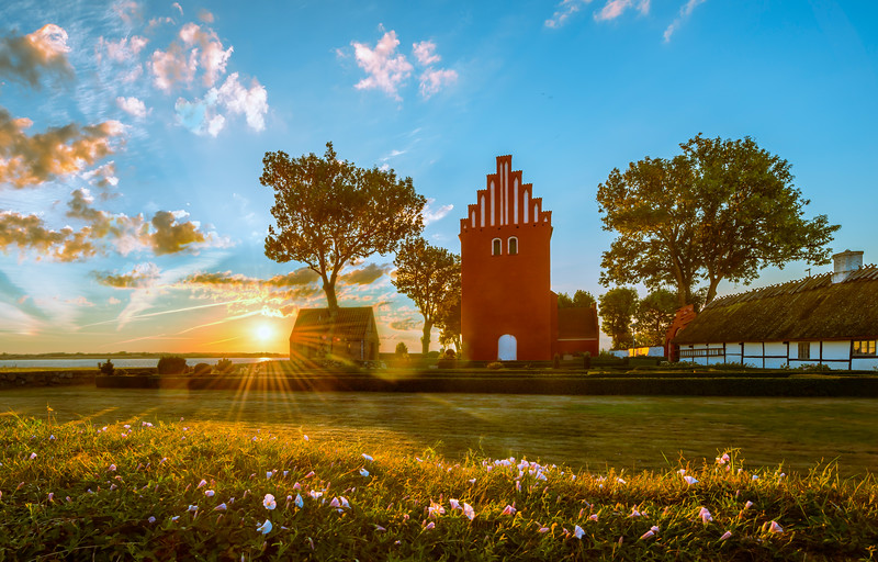 Small red church in the sunrise